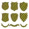 Schilde und Bänder mit gelbschwarzen Streifen