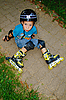 The boy fell roller skates | Stock Foto
