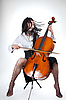 Sensual girl playing cello and moving her hair | Stock Foto