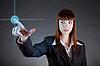 商业女子指着传感器屏幕 | 免版税照片
