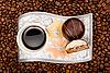 ID 3022615 | Filiżanka kawy z cukierków na fasoli | Foto stockowe wysokiej rozdzielczości | KLIPARTO