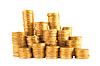 Viele goldene Münzen in Spalten | Stock Foto