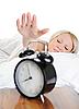 ID 3021679 | Schlafende Frau schaltet den Alarm aus | Foto mit hoher Auflösung | CLIPARTO