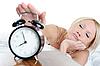 Śpiący kobieta wyłącza alarm | Stock Foto