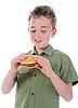 Mały chłopiec jedzenia hamburger | Stock Foto