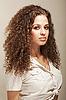 ID 3023080 | Sexy kobieta z długo kręcone włosy na sobie mundur | Foto stockowe wysokiej rozdzielczości | KLIPARTO