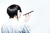 Junge Frau mit Zigarette-Halter | Stock Photo