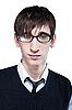 Junger Mann mit modischer Frisur und Brille | Stock Photo