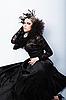 Schöne Frau im schwarzem Kleid | Stock Photo
