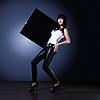 Elegancka młoda dama gospodarstwa pusty pokładzie czarny | Stock Foto