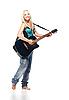 ID 3032458 | Teenager-Mädchen in Jeans spielt Gitarre | Foto mit hoher Auflösung | CLIPARTO