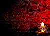 ID 3026922 | Brennende Kerze und dunkelrote Ziegelmauer | Foto mit hoher Auflösung | CLIPARTO
