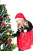 Mädchen und Weihnachtsbaum | Stock Photo