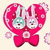 zwei Kaninchen und ein Herz