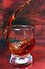 酒精饮料浇成玻璃 | 免版税照片