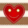Симпатичное улыбающееся джинсовое сердечко