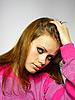 Mädchen in einem rosa Pullover | Stock Foto