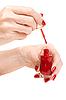 ID 3066453 | Women `s ręce z czerwonym lakierem do paznokci | Foto stockowe wysokiej rozdzielczości | KLIPARTO