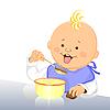 Baby isst mit einem Löffel aus einer Schüssel
