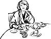 Mädchen im Bademantel am Frühstückstisch