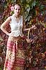 ID 3092919 | Красивая девушка в длинной юбке с корзиной винограда | Фото большого размера | CLIPARTO