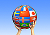 ID 3112655 | Руки держат шар из флагов стран | Фото большого размера | CLIPARTO