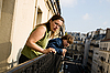 Family on balcony | Stock Foto