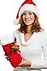 Junge Frau mit Weihnachtsgeschenk | Stock Foto