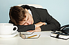 ID 3145545 | Office worker was tired and fell asleep at table | Foto stockowe wysokiej rozdzielczości | KLIPARTO