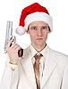 Young man in Christmas hat with gun | Stock Foto