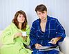 ID 3153593 | Couple in dressing gowns sitting on couch | Foto stockowe wysokiej rozdzielczości | KLIPARTO