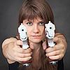 Serious girl aims of two pistols | Stock Foto