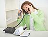 ID 3159761 | Young woman - secretary speaks by several phones simultaneously | Foto stockowe wysokiej rozdzielczości | KLIPARTO