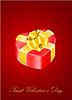 herzförmige Geschenkbox mit goldenem Band