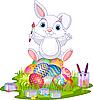 Ostern. Hase sitzt auf Eiern