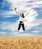 Flying young girl over summer field | Stock Foto