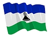 挥舞着国旗莱索托 | 向量插图