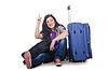 Dziewczyna przygotowuje się do podróży na wakacje | Stock Foto