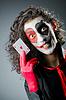 Джокер с маской на лице | Фото