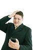 Joven hombre de negocios con aire preocupado | Foto de stock