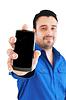 Hombre de negocios con teléfono celular | Foto de stock