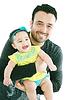Bebé feliz y sonriente y su padre | Foto de stock