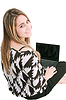 ID 3361417 | Happy young woman using laptop while sittingg on floor | Foto stockowe wysokiej rozdzielczości | KLIPARTO