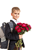 Школьник держит цветы. Снова в школу | Фото
