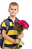 Uczeń trzyma kwiaty. Powrót do szkoły | Stock Foto