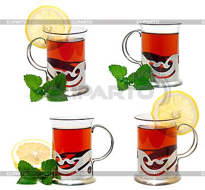 Чай в стеклянном стакане с подстаканником-держателем и веточкой мелиссы | Фото большого размера |ID 3013975