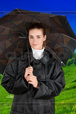 Kobieta pod parasolem | Foto stockowe wysokiej rozdzielczości |ID 3027277