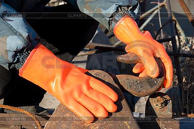 Orange Handschuhe | Foto mit hoher Auflösung |ID 3027990