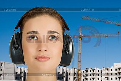 Frau in schützenden Kopfhörer | Foto mit hoher Auflösung |ID 3028171