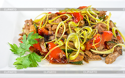 Spicy salad of grilled beef with pepper marinated cucumbers onion